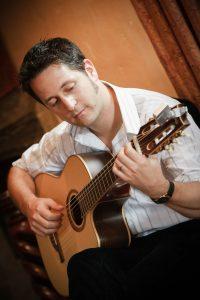 Guitarist Tom on Stage