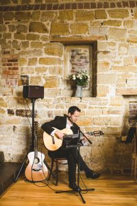 Solo Guitarist on Stage, Stone wall