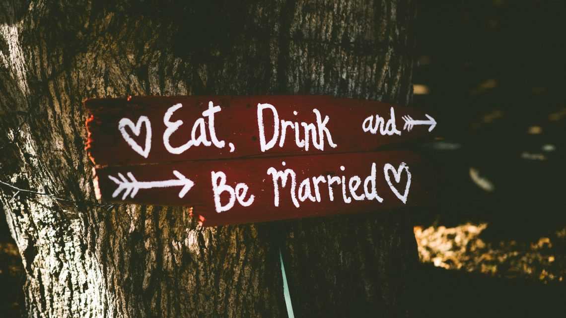 Wedding sign board on tree